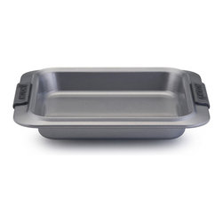 "All-Clad Stainless Steel 10.5"" Lid - Home chefs have the ideal bakeware piece to prepare desserts and other dishes with the Anolon Advanced Nonstick Bakeware 9-"" Square Cake Pan with Silicone Grips. This square cake pan is designed to make baking easier and more efficient  while measuring up to the high standards of serious bakers. Constructed of heavy-duty carbon steel in a medium color tone that aids in even browning  this pan resists warping and provides the even heat distribution fundamental to successful baking results.  Product Features      Heavy duty carbon steel construction   Anolon SureGrip handles for a comfortable grip   Oven safe to 450 Degrees F   Durable nonstick surface allows for effortless food release   Limited lifetime warranty"