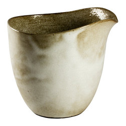 Tan and White Milk Tumbler - The clean lines of this beautiful earthenware milk tumbler are elegant and simple.  Each is slip-cast by hand in black clay and then glazed with a glossy white commercial salt glaze.  As the piece is fired, the glaze gets a tan patina.  The milk tumbler is food-safe, dishwasher and microwave safe. The nature of the clay and Diana's technique make each item distinctly unique, giving each a personality of it's own.  Handmade in South Africa.