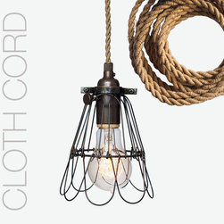 Rustic Trouble Cage Industrial Cloth Cord Pipe Pendant Light - Once reserved for mine shafts and hard hat zones, these fixtures are the ultimate industrial lighting option. Add a cage light over an island or in a bedroom and customize the look by leaving the wire cage open or closed depending on your aesthetic.