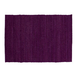 Storm Placemat - Intense tones of deep purple capture the power and majesty of naturese fury. Artisans weave hand-twisted banana fiber on hand looms and bind them with cotton yarn to produce these completely natural and eco-friendly placemats. Banana fiber is an agricultural by-product extracted from banana plants post harvest. These striking placemats can transform any table from mundane to spectacular. Sold individually.    Coordinates with our Storm table runner. Also available in five other colors: Earth, Fire, Forest, Ocean and Sand.    Wipe clean with a damp cloth.