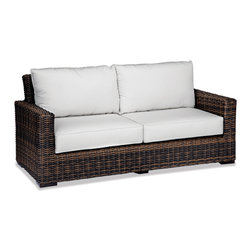 Thos. Baker - Wicker Outdoor Sofa | Hampton Java Collection - Our most popular over-sized wicker collection is now available in a rich java color weave. Premium, dyed-through resin wicker with an extra large diameter profile and a rich variegated rustic finish. Powder-coated aluminum sub-frame and brushed aluminum feet.Plush Sunbrella cushion sets included where applicable. Choose quick ship in khaki with cocoa piping, stone green or choose from our made-to-order fabric options.Made-to-order cushion sales are final and ship in 2-3 weeks.