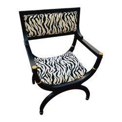Used Lacquer Bucket Chair with Zebra Upholstery - A great bucket style chair in a black lacquer finish with gold accents. This upholstered chair offers a varied frame which makes it a distinctive focal point.  Add this chair in a living room, an office or bedroom for a luxurious accent.