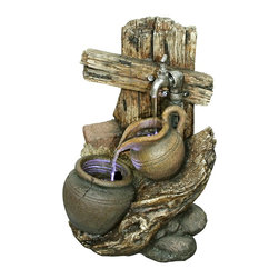 """Lamps Plus - Yosemite LED Faucet Pitcher and Pot Fountain - This beautiful rustic fountain looks like time-worn pottery jugs atop river rocks down by the cleansing waters of a crystal clear stream. Organic textures in stone wood and pottery finishes create an endearing authentic allure illuminated by strategically-placed LED lighting. This finely crafted lightweight polyresin fountain is an easy way to bring the serenity and charm of a water feature into your space. A magnificent accent from Yosemite Fountains rated for indoor or outdoor use. Decorative pitcher and pot fountain. Stone wood and pottery design. Warm brown cool blue and gray stone finish. Illuminated with 3 included single LEDs. Constructed of durable and lightweight polyresin material. Includes 12 feet cord. UL-rated for indoor or outdoor use. 22"""" high. 15 1/2"""" wide. 12 3/4"""" deep.  Decorative pitcher and pot fountain.  Stone wood and pottery design.  Warm brown cool blue and gray stone finish.  Illuminated with 3 included single LEDs.  Constructed of durable and lightweight polyresin material.  Includes pump; 12 foot cord.  Rated for indoor or outdoor use.  22"""" high.  15 1/2"""" wide.  12 3/4"""" deep."""