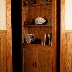 InvisiDoor Hidden Door Bookcase - With the first production hidden door, you are no longer forced to pay custom prices and suffer through long delays for a hidden door. The InvisiDoor can be used to conceal a seldom used room, create a hidden safe room, or turn a door into a functional storage and display area.