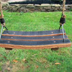 The Oak Barrel Company - Wine Accessories - This swing has been handcrafted using wine barrel staves. Its curved shape makes for a comfortable seat to swing away under your favorite tree. It is treated with outdoor finish to provide seasons of fun while adding to your backyard décor.