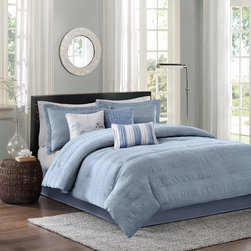 Madison Park - Madison Park Hampton 7 Piece Comforter Set - The Madison Park Hampton Collection adds dimension with the use of fabric manipulation. This unique polyester jacquard fabric has a wrinkle feature that is used in a striped fashion horizontally across the comforter and shams. The dusty blue used in this set gives a modern feel that be easily be added into your current decor. Three decorative pillows use the top of bed color along with a heather grey for a chic finish. Comforter & Sham: 100% polyester jacquard, wrinkle fabric, 100% polyester brushed fabric reverse, 270g/m2 poly fill Bedskirt: 100% polyoni drop, 100% polyester platform 3 Pillows: 100% poly shell, poly fill