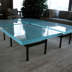 "Glass top Coffee Table - This is a steel based glass top coffee table built by Brandner Design for a client in Jackson Hole Wyoming. The base is made from solid 1"" x 1"" steel bar with a bronze acid patina and 2"" thick blue glass top. The top is four glass squares with a 2"" gap. This design can be custom sized."