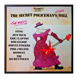 """Glittered Secret Policeman's Other Ball Album - Glittered record album. Album is framed in a black 12x12"""" square frame with front and back cover and clips holding the record in place on the back. Album covers are original vintage covers."""