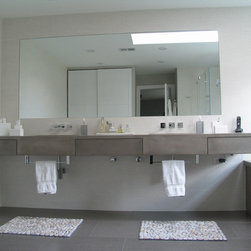 "Concrete Bathrooms - 6"" thick concrete vanity with integral sinks and integral drawers all concrete.  Matching concrete tub surround."