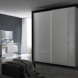 Rossetto USA - Rossetto USA Nightfly 80 in. 2 Door Sliding Wardrobe - White - T412030120068 - Shop for Closet from Hayneedle.com! The charming look of the Rossetto USA Nightfly 80 in. 2 Door Sliding Wardrobe - White will liven up your bedroom decor with glowing good cheer. Contrasting textures and a pure white finish give this exquisite piece a grand presence that can't be denied. The exterior was designed by Italian craftsmen with hardwood solids and veneers for incredible durability and then coated in a glossy lacquer finish that shimmers. But this wardrobe's most fetching quality has to be the unique albino crocodile leather upholstery around the borders and along the hanging rail. Its two sliding doors glide open effortlessly to expose a deep storage space that gives you plenty of room to hang all of your garments and it even has an overhead shelf that's perfect for hats shoes and other treasures set aside for a special occasion. Measures 27W x 80D x 93H inches. Some assembly is required.About Rossetto USA Rossetto USA is the U.S. division of the Arros Group a leading manufacturer that exports Italian furniture style and design all over the world. Operating out of its warehouse in High Point N.C. since 1999 Rossetto provides complete contemporary and modern dining bedroom and occasional furniture programs that combine affordable price with innovative Italian design to satisfy the demands of their distinguished customers.