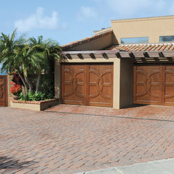 La Jolla Custom Wood Garage Doors - For this home we worked with the homeowner to design garage doors and a gate that would match the design of their front entry doors.  The garage doors and gates are constructed of African Mahogany.
