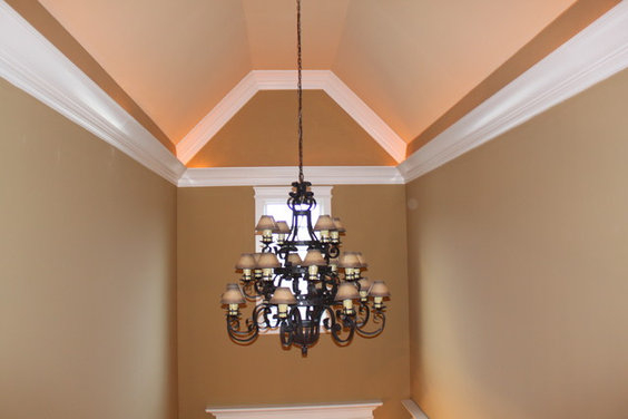 Two story foyer light fixtures make such an impact
