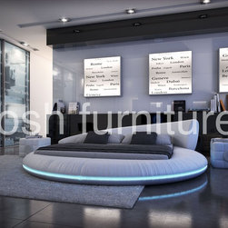 Tosh Furniture - Modern Round LED Platform Bed - King - Modern upholstered round LED platform bed. Rich textures, divine design elements and a head turning finished look is what defines this ultra modern Tosh Furniture LED platform bed. Note the soft blue light that's built right into the base. Your attention is then drawn to the sophisticated head base that gives abstract a whole new meaning. It incorporates a traditional mattress and the eco friendly leather makes it a responsible choice, too. You can choose any color, though keep in mind, these require a special order. Enjoy the casual look and feel this design delivers every time you enter the room.