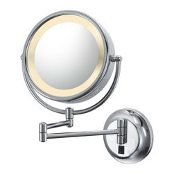 """Lamps Plus - Aptations Chrome Hardwired Swing Arm Lighted Vanity Mirror - This lighted swing arm wall mirror has all the features you need to look your best. The mirror face is double sided including one side for standard viewing and the other for 5x magnified viewing. Swing arm and tilt design allows you to position the mirror exactly where you want it. Backplate with on/off switch neatly conceals mounting hardware. Design by Aptations. Chrome finish. 1x/5x magnification. Hardwired installation. Takes one 25 watt bulb (included). 12 1/2"""" wide. 15 1/4"""" high. Mirror is 8 3/4"""" wide. 15"""" extension. Mounting plate is 5 3/4"""" wide.  Chrome finish.   1x/5x magnification.   Hardwired direct wire mirror design.  Adjustable mirror.  A great size for bath or make up areas.  Lighted mirror.  Takes one 25 watt bulb (included).   12 1/2"""" wide.   15 1/4"""" high.   Mirror is 8 3/4"""" wide.   15"""" extension from the wall.   Mounting plate is 5 3/4"""" wide."""