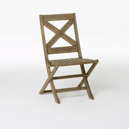 Jardine Folding Chair - I love the natural wood and the simple, classic shape that recalls cafés in Provence. These chairs even are petite enough to work on some small balconies.