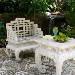 Horchow - Fretwork Table - Exclusively ours. Create a relaxing corner in the garden with this lightweight yet durable table and chair. A Greek Key pattern around the aprons and inwardly curled feet add to their charm. Imported. Handcrafted of crushed stone/polyester resin/styr...