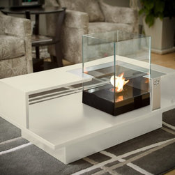 """DecorPro 40"""" x 24"""" LEVEL Compact Coffee Table D50142 - * Relax in luxury and enjoy the glow and warmth of the Decorpro LEVEL COMPACT Coffee Table. This coffee table allows you to enjoy a crackling fire in the privacy of your own home. The LEVEL COMPACT Coffee Table is perfect for a smaller room or a condo. Its the perfect way to entertain in style. Designed as a three in one furniture piece it has a variety of options on how it can be utilized. As a fireplace using Organica BioFire Safety Fuel™ multiple use fuel canister to create a beautifully warm flame. For a different kind of ambiance fill the unit up with pillar candles. You can also transform the burner unit into a terrarium that can be filled with your favorite plants. The options are endless."""