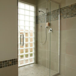 Island Stone Random Tile shower floor - Popular for its flat surface and exclusive seamless interlock, Island Stone Random Tile is a great option for a shower floor
