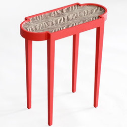 Tini Table II Z - If a solid color just isn't your style, this tiny table with upholstered top is just the thing. The animal print adds a touch of the unexpected. We like this table for beside a bed.