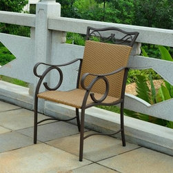 Valencia All-Weather Wicker Patio Dining Chair - Set of 2 - Curvaceous steel frames support the Valencia All-Weather Wicker Patio Dining Chair - Set of 2. A refined matte brown powder coat finish coordinates with the honey pecan wicker seat and back support. Resin wicker provides comfortable support and a tidy, stylish look while resisting rot, weather damage, and UV rays. This pair of chairs can certainly hold its own outside, but the look is so compelling that you won't hesitate to invite them into your patio, sunroom, or casual dining area.About International Caravan, Inc.For nearly half a century, International Caravan, Inc. has been scouring the world for unique furniture and home decor products to bring to the international market. Today, International Caravan, Inc. is ranked as one of the leading import and wholesale distributors in the nation. Their products can be found on the largest E-commerce websites as well as in America's leading retail stores.