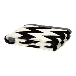 Zigzag Chevron Throw - Black/Milk/Smoke - Grey edging softens the strong noir drama of the black and white geometric pattern that fills the surface of the ZigZag Chevron Throw in Black, Milk, and Smoke. Made from a mix of recycled fibers for an eco-friendly, temptingly silky knit, this cotton-blend throw blanket is a striking achromatic detail for making a stylish home feel lived-in.