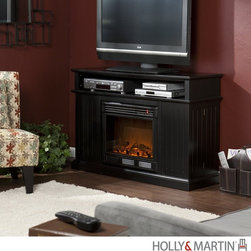 """Holly and Martin Fenton Media Electric Fireplace-Black - 37-100-084-6-01 - Holly & Martin Fenton Media Electric Fireplace-BlackProduct Features If you are seeking a fireplace that has it all, this is the one for you. A black finish makes this simple fireplace a standout. Fluted panels on either side of the mantel open to reveal eight spacious storage shelves for all of your favorite media. Atop the firebox rests a media equipment storage shelf that is complete with convenient back wall cord access. Crisp edges complete the design of this classic fireplace. Requiring no electrician or contractor for installation allows instant remodeling without the usual mess or expense. In addition to your living room or bedroom, try moving this fireplace to your dining room for a romantic dinner or complement your media room with a ventless fireplace below your flat screen television. Use this great functional fireplace to make your home a more welcoming environment. - 48"""" W x 15"""" D x 32.25"""" H  - Eight spacious storage shelves- 8"""" W x 6"""" D x 10.25"""" H  - Media equipment shelf- 42.5"""" W x 13"""" D x 5"""" H  - Black finish  - Secure magnetic shelf closure  - Two cord management options in the back of the unit  - Great media storage accessory  - Max weight capacity 85 lbs  - Accommodates up to a 50"""" flat screen TV  - Constructed of solid wood, MDF and PB  - Assembly required   - Firebox front - 23"""" Wide x 20"""" Tall  - Remote control (2 AAA Batteries Required)  - Realistic flickering flame effect  - Long life LED lights  - 120V-60Hz, 1500W / 5000 BTUs, 12.5 Amp  - Easy to use adjustable thermostat  - Safety thermal overload protector  - Adjustable flame brightness control  - Plugs into standard wall outlet with 6' cord  - Tested to heat 1500 cubic feet in only 24 minutes (14'x14'x8')  - Uses about the same energy as a coffee maker  - 100% energy efficient with low operating costs  - Produces zero emissions or pollutants  - Eco friendly, consuming no wood or fossil fuels  - No combustion, glas"""