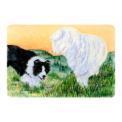 Caroline's Treasures - Border Collie Kitchen or Bath Mat 24 x 36 - Kitchen or Bath Comfort Floor Mat This mat is 24 inch by 36 inch. Comfort Mat / Carpet / Rug that is Made and Printed in the USA. A foam cushion is attached to the bottom of the mat for comfort when standing. The mat has been permanently dyed for moderate traffic. Durable and fade resistant. The back of the mat is rubber backed to keep the mat from slipping on a smooth floor. Use pressure and water from garden hose or power washer to clean the mat. Vacuuming only with the hard wood floor setting, as to not pull up the knap of the felt. Avoid soap or cleaner that produces suds when cleaning. It will be difficult to get the suds out of the mat.