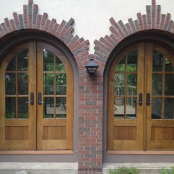 Custom built arched oak entry doors - Beautiful solid white oak arched entry doors custom built by John Huisman. http://huismanconcepts.com/