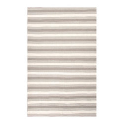 Birch Gray Indoor/Outdoor Rug, 5' X 8' - Each steel-grey stripe in the Birch Gray Indoor-Outdoor Rug is bordered by a mingled band of grey with the white that lies between them. As a result, the rug has a rhythmic, balanced pattern of light and shadow that reduces the contrast and abruptness of the stripes, a sophisticated and fresh take on a classic pattern. Enjoy the reversible rug's interest indoors and out.