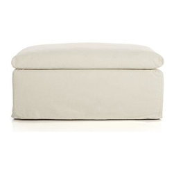 Serene Slipcovered Ottoman and a Half - Sturdy box frame sets the foundation for an extra-fluffy duvet seat or footrest. Relaxed, natural cotton-linen slipcover in bone is washed and brushed to exceptional softness to make this a favored destination for settling in.