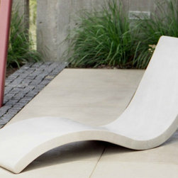 Jenner Lounge - Even though it's made of concrete, the curved design of this chaise lounge makes it a comfy patio seat.