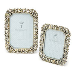 Crystal and Pearl Photo Frames - Set of 2 - Embracing the techniques of mosaic in an updated, scintillating form, the Set of Two Crystal and Pearl Photo Frames are perfect for wedding portraits, but also for adding eliteness to a space as artwork frames.  The particular tints of the pale pearls make these frames a superb addition to a room with mixed-metal accents as well as spaces with a purer emphasis on the elegance of silver.