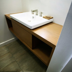 Nevada St., S.F. - Bernal Heights residence - San Francisco, Calif. Cantilevered bathroom vanities, shower bench, and window shutter in clear-finished Teak. Push-release hardware on vanity drawers and window shutter.