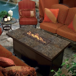 O.W. Lee Casual Fireside Largo 36 x 58 in. Rectangle Fire Pit Table - It doesn't take much to get people to gather outdoors, but the O.W. Lee Casual Fireside Largo 36 x 58 in. Rectangle Fire Pit Table is going to be more than enough reason to enjoy your outdoor space all year long. Starting with a rugged frame of wrought iron, this rectangular fire-pit supports a wide burner that runs the length of the table and uses a standard propane canister. Around the burner is a wide surface that can be customized with a full range of materials, from tile to cast aluminum. Inside that burner you've got a number of media choices that range from traditional ceramic logs to chic pebbles of fire-proof glass. Pick the finish of your choice for the frame and you'll discover that you've created a new outdoor centerpiece that's uniquely you. Get your shoes on, because it's time to go outside.Materials and construction: Only the highest quality materials are used in the production of O.W. Lee Company's furniture. Carbon steel, galvanized steel, and 6061 alloy aluminum is meticulously chosen for superior strength as well as rust and corrosion resistance. All materials are individually measured and precision cut to ensure a smooth, and accurate fit. Steel and aluminum pieces are bent into perfect shapes, then hand-forged with a hammer and anvil, a process unchanged since blacksmiths in the middle ages. For the optimum strength of each piece, a full-circumference weld is applied wherever metal components intersect. This type of weld works to eliminate the possibility of moisture making its way into tube interiors or in a crevasse. The full-circumference weld guards against rust and corrosion. Finally, all welds are ground and sanded to create a seamless transition from one component to another. Each frame is blasted with tiny steel particles to remove dirt and oil from the manufacturing process, which is then followed by a 5-step wash and chemical treatment, resulting in the best possible surface for the final finish. A hand-applied zinc-rich epoxy primer is used to create a protective undercoat against oxidation. This prohibits rust from spreading and helps protect the final finish. Finally, a durable polyurethane top coating is hand-applied, and oven-cured to ensure a long lasting finish. About O.W. Lee Company An American family tradition, O.W. Lee Company has been dedicated to the design and production of fine, handcrafted casual furniture for over 60 years. From their manufacturing facility in Ontario, California, the O.W. Lee artisans combine centuries-old techniques with state-of-the-art equipment to produce beautiful casual furniture. What started in 1947 as a wrought-iron gate manufacturer for the luxurious estates of Southern California has evolved, three generations later, into a well-known and reputable manufacturer in the ever-growing casual furniture industry.