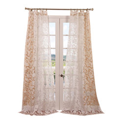 Exclusive Fabrics & Furnishings, LLC - Alesandra Patterned Sheer Curtain - This sheer white patterned curtains gives you a delicate frame for your windows without completely blocking the view or the light. The sweet vine-like pattern creates a subtle visual filter but lets the daylight come softly through.