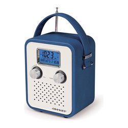 Crosley Radio - Songbird Portable Radio - Blue - AM/FM Alarm clock radio. Digital tuner. Dynamic full range speaker. Portable audio ready (simply plug in you portable device of MP3 player). Wood style cabinet. Vinyl wrapped. AC power adapter. 4 AA batteriesConveniently carry your music wherever you want with Crosley's portable Songbird radio. This vintage-style radio features a soft yet durable carry strap, is battery powered or can be used indoors with the included AC adapter. Tune in or wake up to your favorite station using the digital AM/FM tuner with alarm clock, or just plug in your iPod, MP3 player or other audio device into the Portable Audio Ready (PAR) input. Let the music take you!