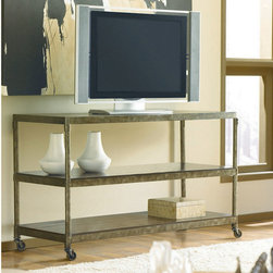 "Hammary - Hammary Structure Console Table - There is beauty in simplicity. And seldom does furniture possess more effortless beauty than Hammary's new ""Structure"" collection. We have stripped away the excesses of modern design and focused on the bare essentials to produce an 11-piece collection that pays tribute to the precision and straightforward creations of the industrial age. Inspired by the stark  utilitarian designs from the early 20th Century  these pieces are crafted from metal and birch veneers and cleverly incorporate materials such as pipes  rivets  scythed wood  wheels and metal banding. Table tops are banded in metal - an idea borrowed from heavy-duty industrial trolleys - to create a unique touch of style and to enhance durability. Meanwhile  the heavily distressed finish creates a well-worn feel that will transform any room. This versatile group includes occasional tables and home office pieces  as well a media console and a rolling desk chair. Especially interesting is the vintage artist's easel  which comes with a universal mounting plate and has been repurposed to hold a flat-screen TV. Sometimes  sophistication comes in the most simple of designs. ""Structure"" from Hammary."