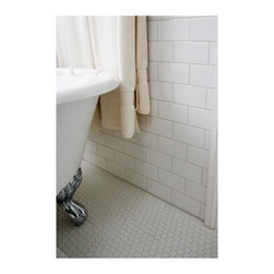 Porcelain Tile - Bathroom with porcelain tiles on the floor and white 3x6 ceramic tiles on the wall.