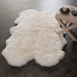 Safavieh - Sheep Skin White Rectangle: 5 Ft. In. x 8 Ft. In. Area Rug - - Sheepskin shag rug is made from an authentic sheepskin hide and adds warm and personality to any room.  - Color: White  - Pile Height: 1  - Material: Sheepskin, Wool  - Weave: Handmade Safavieh - SHS121A-5