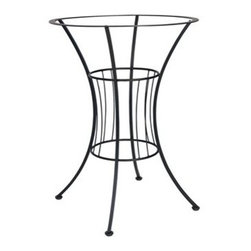 Woodard - Woodard Easton Wrought Iron 30.5 Bar Height Table Base - The Woodard Easton furniture collection is a design lesson in the effective use of arcs and angles. Its expressive use of geometric figures � made of durable wrought iron no less � is the creative handiwork of Woodard�s master artisans. Each piece includes many subtle upscale details that let you know that this set will give you complete satisfaction for years to come. Look at the symmetry and precision in the wrought iron chair backs the table bases and Easton wrought iron patio loveseat. You won�t find this level of workmanship in other manufacturers� outdoor patio furniture.With the Easton furniture collection you have free range to customize your set from the powder coated rust-fighting finishes on the frames to the standard and designer fabric options including trim detail and chair ties in more than 30 colors and design choices. If you have other outdoor furniture for example a patio furniture glider from another maker you can get a replacement cushion for it and blend it in with the Easton furniture pieces you select.The name Woodard Furniture has been synonymous with fine outdoor and patio furniture since the 1930s continuing the company�s furniture craftsmanship dating back over 140 years. Woodard began producing hand-made wrought iron furniture which led the company into cast and tubular aluminum furniture production over the years.� Most recently Woodard patio furniture launched its entry into the all-weather wicker furniture market with All Seasons which is expertly crafted and woven using synthetic wicker supported by an aluminum frame.� The company is widely known for durable beautiful designs that provide attractive and comfortable outdoor living environments.� Its hand-crafted technique used to create the intricate design patterns on its wrought iron furniture have been handed down from generation to generation -- a hallmark of quality unmatched in the furniture industry today. With deep seating slings and metal seating options in a variety of styles Woodard Furniture offers the designs you want with the quality you expect.  Woodard aluminum furniture is distinguished by the purest aluminum used in the manufacturing process resulting in an extremely strong durable product which still can be formed into flowing shapes and forms.� The company prides itself on the fusion of durability and beauty in its aluminum furniture offerings. Finishes on Woodard outdoor furniture items are attuned to traditional and modern design sensibilities. Nineteen standard frame finishes and nineteen premium finishes combined with more than 150 fabric options give consumers countless options to design their own dream outdoor space. Woodard is also the exclusive manufacturer of outdoor furnishings designed by Joe Ruggiero home decor TV personality.� The Ruggiero line includes wrought iron aluminum and all weather wicker designs possessing a modern aesthetic and fashion-forward styling inspired by traditional Woodard patio furniture designs. Rounding out Woodard�s offerings is a line of distinctive umbrellas umbrella bases and outdoor accessories.� These offerings are an integral part of creating a complete outdoor living environment and include outdoor lighting and wall mounted or free standing architectural elements � all made with Woodard�s unstinting attention to detail and all weather durability. Woodard outdoor furniture is an American company headquartered in Coppell Texas with a manufacturing facility in Owosso Michigan.� Its brands are known under the names of Woodard Woodard Landgrave and Woodard Lyon Shaw. With a variety of collections Woodard produces a wide array of collections that will be sure to suit any taste ranging from traditional to contemporary and add comfort and style to any outdoor living space. With designs materials and construction that far surpass the industry standards Woodard Patio Furniture creates beauty and durability that is unparalleled.