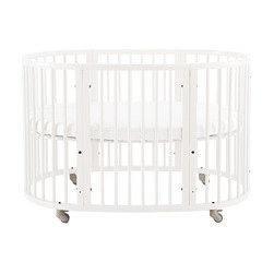 Sleepi Crib-Bed | Stokke - The crib is clearly one of the defining decisions that determines the look and feel of the nursery. Whether you buy into the idea that round cribs are soothing because they simulate the shape of the womb or you're simply looking for something a little less sharp, this Stokke crib is the perfect fit. We chose it for its clean, modern lines.