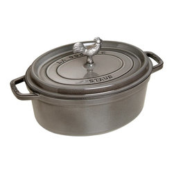 Staub - Staub Coq au Vin Cocotte 5.75 qt. - Graphite Gray Multicolor - 1123118 - Shop for Dutch Ovens from Hayneedle.com! Professional and aspiring cooks love the Staub Coq au Vin Cocotte 5.75 qt. - Graphite Gray. This cast iron pan is ideal for stews roasts soups casseroles and other one-pot classics. Constructed of cast iron this incredibly durable pan features an extra-heavy lid that seals moisture in and dozens of well-placed spikes that continuously baste the pans contents ensuring your dish retains the full flavor of each ingredient. When it's time for clean up simply pop this pan into the dishwasher. The high-quality enamel coating resists scratches and will never discolor.About Staub CookwareFrom professional chefs to home cooks people with a passion for cooking rely on Staub cookware. Combining the utility of cast iron with the latest technology available Francis Staub designed his first enameled pot in 1974 in the Alsace region of France. Known for performance style and durability Staub has become the benchmark for enameled cast-iron cookware. Ideal for braising searing roasting and caramelizing food Staub's signature pots - called cocottes - feature an enameled interior with a matte black finish. Resistant to rust chipping and cracking cocottes are available in round and oval shapes in a variety of sizes and colors. Just right for slow-cooking food Staub cocottes are designed to provide even heat distribution excellent heat retention and continuous self-basting. The inside of each heavy snug-fitting lid features a series of bumps (or self-basting spikes) to allow continuous natural basting by distributing moisture throughout for extra flavor and tenderness. In addition to its signature cookware which is perfect for serving at the table Staub also offers pans for frying sauteing grilling and roasting as well as a variety of teapots accessories and gourmet specialty items.