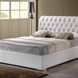 Baxton Studio Bianca Modern Platform Bed - White - Create a plush, modern escape in your master bedroom with the Baxton Studios Bianca Modern Bed - White. Lush elegance comes from its padded and deeply tufted headboard. Its sleek platform design and white faux leather upholstery lend contemporary grace. Because it's a platform bed this beauty requires no box spring, simply your mattress. It comes in your choice of size. Bed Dimensions: Headboard height: 43.3 inches Footboard height: 13.7 inches Full size bed: 87.7L x 56W x 43H inches Queen size bed: 92.7L x 62W x 43H inches About Baxton StudiosThis item is designed and manufactured by Baxton Studios, a furniture company based near Chicago. A lot goes into the making of Baxton Studios furniture, and it all starts with attention to details. They hand select their unique line of leather and micro-fiber fabrics. Their furniture is padded with high polyurethane foam to create the body contouring comfort and support for which Baxton Studios is famous. All frames are constructed of high quality wood or steel on select models, providing sturdy frame construction that exceeds industry standards. Baxton Studios is committed to constantly providing stylish and unique furniture for the best value to help you create a comfortable living space with ease and confidence.