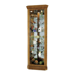 Howard Miller - Dominic Corner Curio Cabinet w 7 Glass Shelve - Tower styling and multiple shelves provide all the room you'll need for display. Our Dominic curio cabinet adds charm with its wood-grained cabinet. It's designed for corners, which makes it perfect for small rooms. A full glass front offers exceptional viewing of your special pieces. Offers a full picture-frame view of eight levels of display space with seven glass shelves. Pad-Lock cushioned metal shelf clips increase stability and safety. Glass shelves can be adjusted to any level within your cabinet. Adjustable levelers under each corner provide stability on uneven and carpeted floors. Glass mirrored back beautifully showcases your collectibles. No-Reach light switch is conveniently located on the back of the cabinet. Legacy Oak Finish. Made of Hardwoods and Veneers. 28 in. W x 16 in. D x 80 in. H