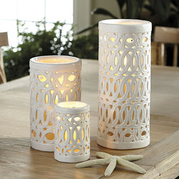 "Ballard Designs - Geometric Hurricane - Large & Medium hold 4"" pillar. Small size holds 3"" pillar. White finish. Great with our remote controlled flameless candles. From fabrics and rugs to accessories, geometrics are one of our favorite accents. These pierced ceramic hurricanes allow the candlelight to flicker through, highlighting the interlocking ring designs and casting a romantic Mediterranean mood over your mantle or table. Geometric Hurricane features: . . . ."