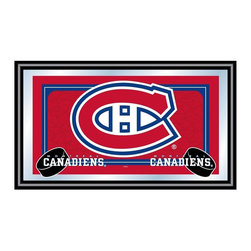 Trademark Global - Framed NHL Montreal Canadiens Team Logo Mirro - Showcase your team pride with this colorful decorative wall mirror, featuring the officially licensed Montreal Canadiens team colors and logo on the center. The mirror has a black wrapped wood frame for added visual interest, and would be a dramatic addition to any game room or bar area decor. Great for gifts and recreation decor. Mirror with print. Black wrapped wood frames. 26 in. W x 15 in. H (10 lbs.)This National Hockey League Officially Licensed Team Logo Wall Mirror is the perfect gift for the Hockey Fan in your life.