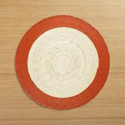 Tropic Palm Spice Trim Placemat - Colorful round with contrasting rim is handmade from natural palm fibers and sealed with a wax finish for easy cleanup.