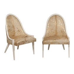 Hide Slipper Chair - If a pair of slipper chairs is the right size and shape but seems a little too dainty for the space, covering them in cowhide adds weight and makes them feel a touch less feminine.