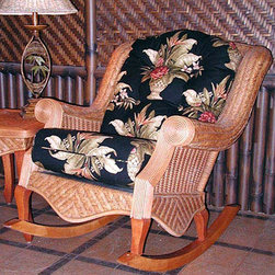 Spice Island Wicker - Rocker Chair (Siesta Pompeii - All Weather) - Fabric: Siesta Pompeii (All Weather)For those of you that enjoy a little bit of motion, even when you're relaxing to your utmost, this eloquently gorgeous wicker rocker is what you have always wanted, but never found.  Until now.  With the exquisitely beautiful cinnamon finish and the gorgeous cushion made with the fabric of your choice, your search is finally over!  Sink into affordable luxury in this deep-seated rocking chair.  Rolled armrests add comfort with waved skirt and cinnamon finished rocker rails for added appeal. * Solid Wicker Construction. Cinnamon Finish. For indoor, or covered patio use only. Includes cushion. 31 in. W x 42 in. D x 36.5 in. H