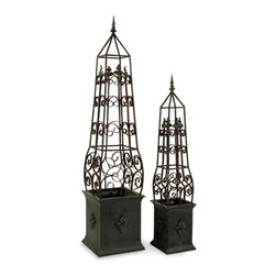 """IMAX CORPORATION - Antique Topiaries - Set of 2 - Antiqued, hand wrought iron topiaries. Set of 2 in various sizes measuring around 51""""L x 13""""W x 13""""H each. Shop home furnishings, decor, and accessories from Posh Urban Furnishings. Beautiful, stylish furniture and decor that will brighten your home instantly. Shop modern, traditional, vintage, and world designs."""
